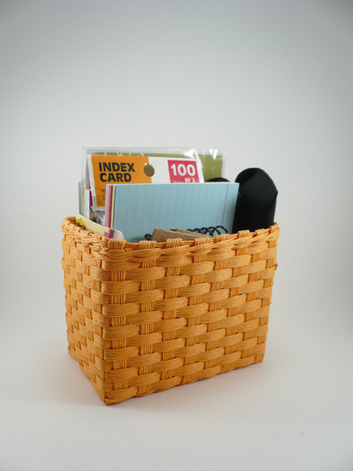 basket of office supplies